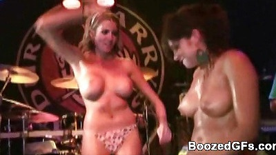 Chick shaking thise big boobs infront of the crowd
