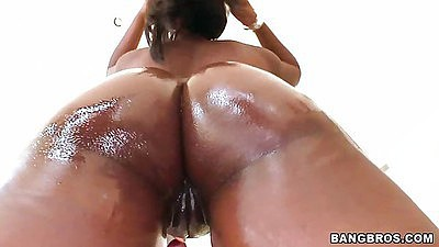 Brown ass oiled up and shaved pussy Coffee Brown