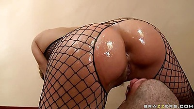 Oiled up ass in fishnets on the stair case licking ass