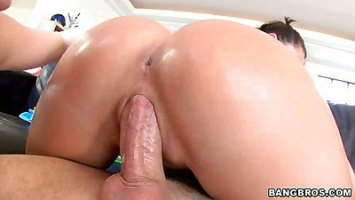 Close up view of oiled up ass in reverse cowgirl