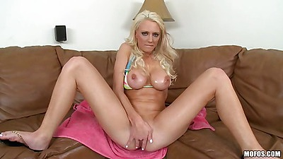 Fingering her own shaved pussy in oil