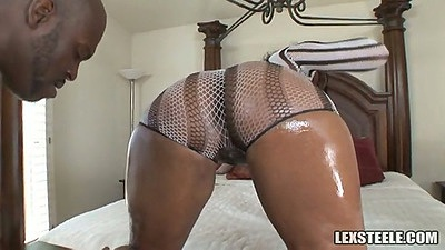 Big round black ass Vanessa Monet gets oiled up and doggy style fuck