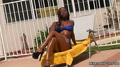 Outdoor all natural cutie in bikini posing and getting oil on body