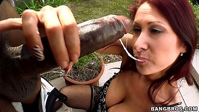 Tiffany Mynx milf sucking a huge black cock outdoors