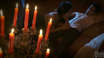Kiara Mia sucking dick under some candles