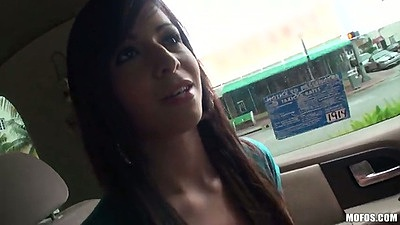 Teen latina Layla Lopez driving around in a miniskirt in backseat on the street