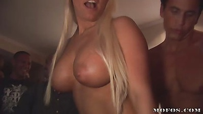 Tanned blondie naked showing amaizing tits